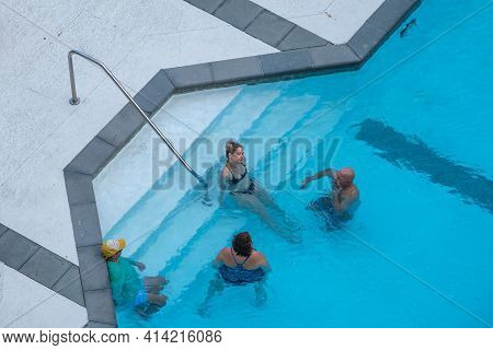 New Orleans, La - October 26: Aerial View Of Two Couples Enjoying Themselves In Swimming Pool On Oct