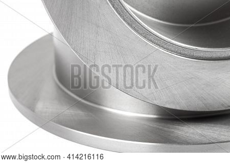 Pair Of Brake Discs Close-up Texture Of Polished Surface Of Alloy Disc.