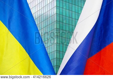 Flag Of Ukraine And Russia Flag Close-up. The Concept Of Political And Economic Relations Of States.