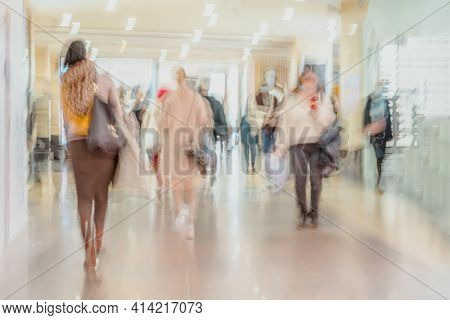 Abstract Defocused Motion Blurred People Walking In Shopping Mall Center, Urban Lifestyle, Consumeri