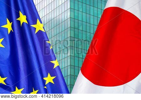 Flag Of Japan And European Union Flag Close-up. The Concept Of Political And Economic Relations Of S