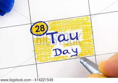 Woman Fingers With Pen Writing Reminder Tau Day In Calendar. June 28.
