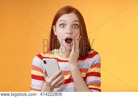 Concerned Shocked Emotive Redhead Girl Find Out Stunning News Look Camera Drop Jaw Gasping Impressed