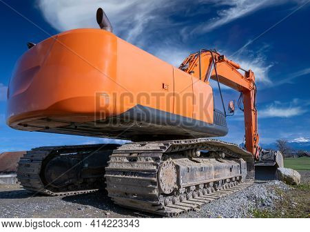Orange Crawler Excavator On The Construction Site. Clearing, Grading, Excavation Of Trenches, And Of