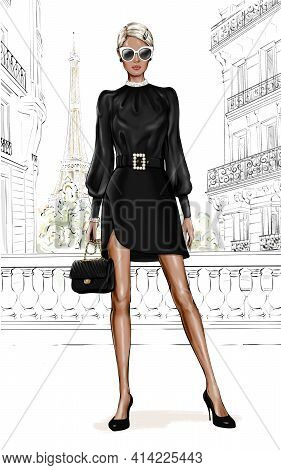 Beautiful Young Girl In Fashion Clothes. Stylish Woman With Paris Background. Fashion Girl Holding B