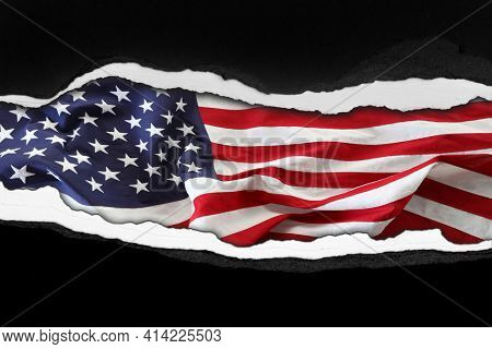 Ripped paper and American flag