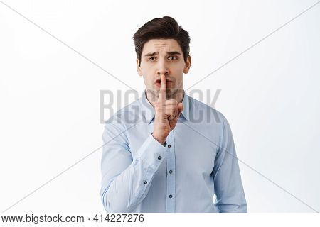 Man Office Worker Shushing, Asking To Keep Quiet, Press Finger To Lips, Shhh Gesture, Standing Over