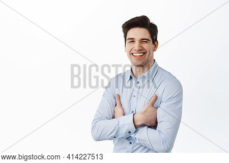 Successful And Confident Ceo Corporate Man Winking, Smiling Satisfied, Encourage You, Standing Deter