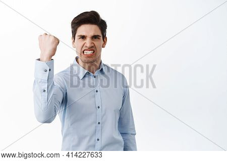 Angry Office Worker Shaking Fist In Threaten, Look Outraged And Pissed-off, Standing Frustrated Agai