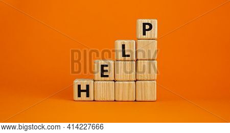 Support And Help Symbol. Pyramid From Wooden Cubes With The Word 'help'. Business, Psychology, Suppo
