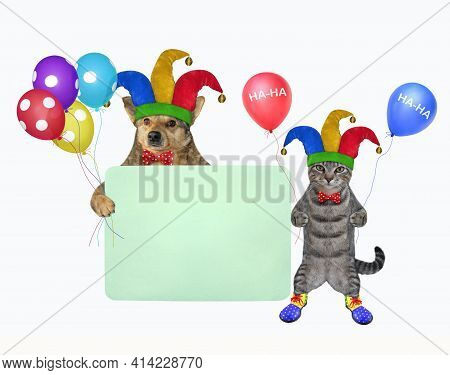 Pets Clowns In Holiday Hats With Balloons Is Near A Green Blank Poster. White Background. Isolated.