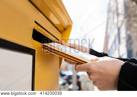 Letter In Envelope Or Document In Mailbox. Man Hand Sending Mail