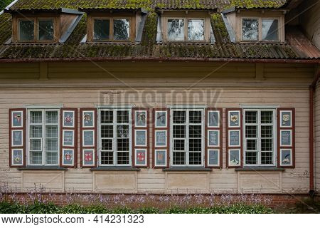 Rokiskis, Lithuania - July 16, 2017: Building With Famous Painted Shutters On The Windows. Shutters