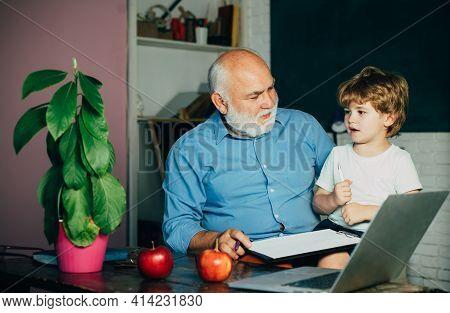 Grandfather And Grandchild. Cute Little Preschool Kid Boy With Grandfather In A Classroom. A Grandfa