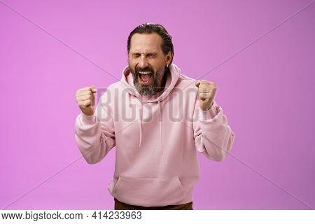 Accomplished Happy Joyful Triumphing Mature 40s Bearded Man Grey Hair Yelling Yes Thrilled Joyfully