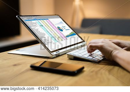 Electronic Spreadsheet Software And Auditor Analysis On Laptop