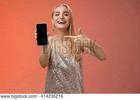Boastful Proud Charming Elegant Blond Woman In Stylish Evening Dress Show Smartphone Display Proudly