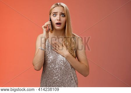 Concerned Worried Woman Blond Hairstyle In Silver Stylish Glittering Dress Hold Hand Heart Widen Eye