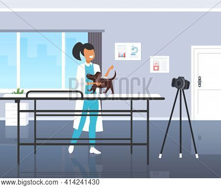 Female Veterinarian Blogger Checking Dog At Veterinarian Clinic Woman Recording Online Video With Ca