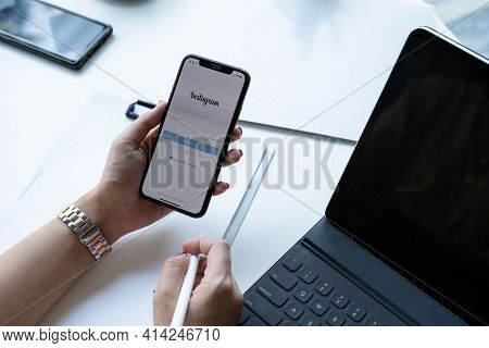 Chiang Mai, Thailand - Nov 07, 2020 : Woman Hand Holding Iphone With Login Screen Of Instagram Appli