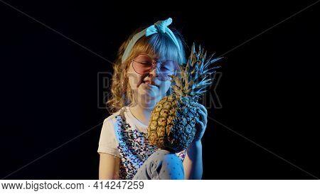 Trendy Stylish Girl With Pineapple Telling Something, Waving Bye, Winking. Child Kid In Neon Lightin