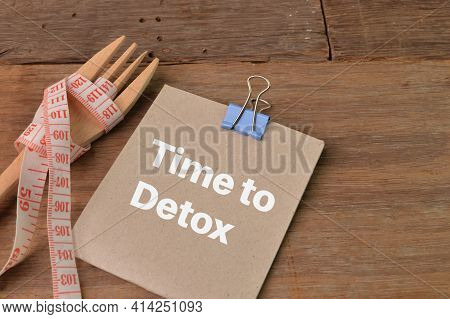 Fork, Measuring Tape And Memo Note Written With Time To Detox