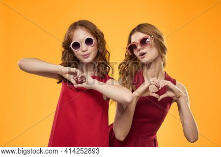 Mom And Daughter Fun Moda Studio Communication Yellow Background