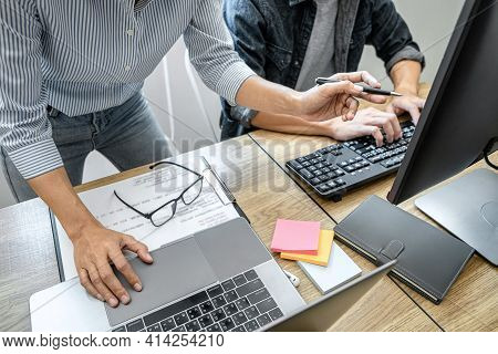 Two Professional Programmer Cooperating And Working On Web Site Project In A Software Developing On
