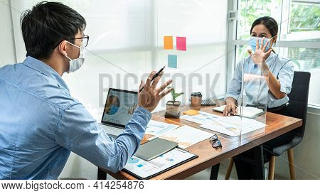 Two Business Colleagues Wearing Face Mask To Brainstorming Business Project And Giving High Five To