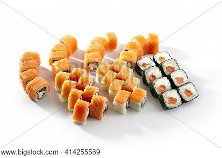 Sushi Rolls Set with Various Salmon Maki Rolls. Maki sushi rolls on white background