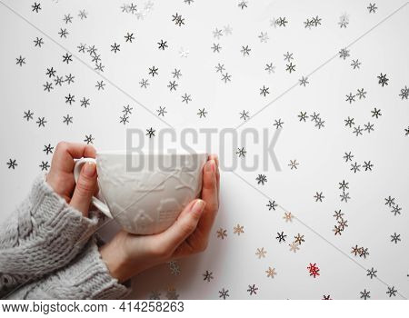 Cup With Marshmallows On A White Background With Silver Snowflakes