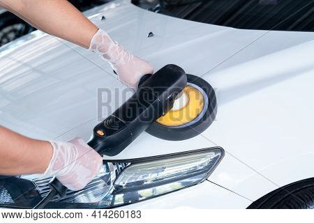 Car Wash Service Concept, Coating Cars. Polishing Of The Car Will Help Eliminate Contaminants On The