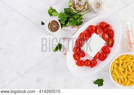 Preparation Of Ingredients For Fetapasta. Trending Feta Bake Pasta Recipe Made Of Cherry Tomatoes, F
