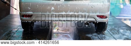 Close Up Photo Of A Man Hands Washes His Car With A Large Head Of Water From A Karcher And Washing C