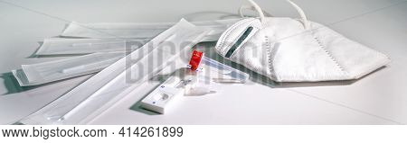 Covid-19 Rapid Antigen Self Test For Diagnostic At Home And A Ffp-2 Mask On A Light Gray Background,