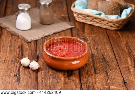 Russian Red Soup Borsch In Clay Plate.