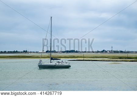 View From The Beach Of La Patache On The Preparingof  A Boat For Sailing With The Church Of Ars-en-r
