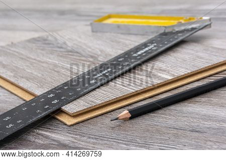 Construction Square And Pencil On The Laminate. Equipment For Installing Laminate Flooring. Floor Re