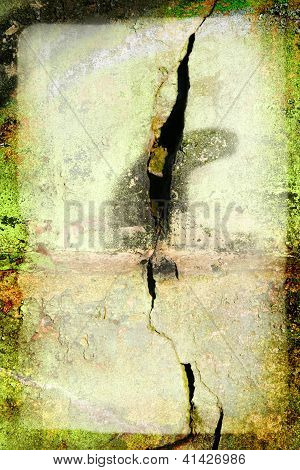 Grunge background / texture with frame / border on a cracked green stone wall with splashes of paint. Big crack in center of the wall. poster