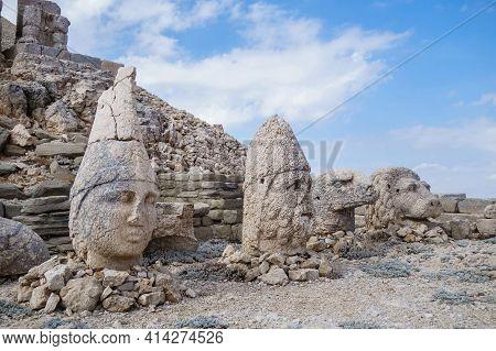 Heads Of Ancient Statues Of Apollo, Hercules, Eagle & Lion On Mount Nemrut, Kahta, Turkey. Complex W
