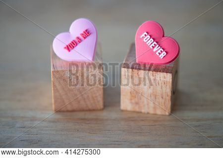 You And Me Messages Written On Pink Heart Shape And Forever Messages Written On Red Heart Shape Put