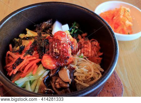 Delectable Bibimbap, A Korean Traditional Mixed Rice With Meat And Assorted Vegetables In Hot Stone