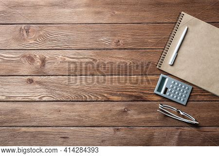 Still Life Of Accountant Vintage Workspace With Office Accessories. Flat Lay Old Hardwood Desk With