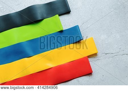 Fitness Elastic Bands On A Light Background, Top View In Close-up