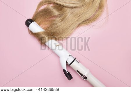 Hair Curling With An Iron. Hairdressing And Training. Creation Of Evening Hairstyles Of Fashionable