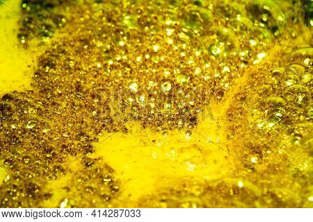 Golden Foam. Background And Texture Concept. Close Up Of Bubbling Golden Foam. Foam Texture As Backg