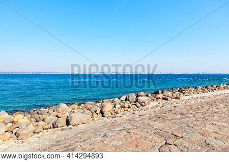 Breakwater Giant Boulders . Coast Of Oresund Bay Between Denmark And Sweden