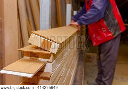 Carpentry Worker Arranged Gluing Wooden Profiles At Workshop And Prepares Them For Squeezing In Clam