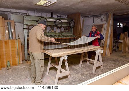Carpenters Assemble Wooden Profiles Smeared With Glue And Prepare Them For Squeezing In The Wood Pre