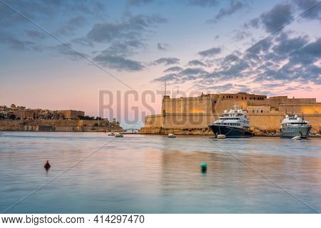 Battlement walls of the old town in Birgu at sunset, Malta